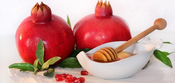 symbols of holiday of Rosh Hashanah - honey and pomegranate